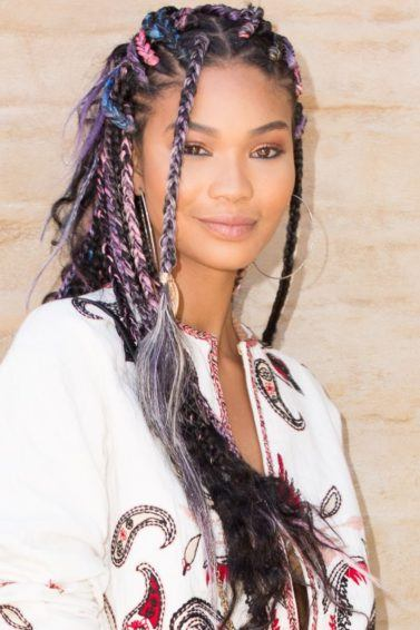 close up of chanel iman with loose box braids hairstyle