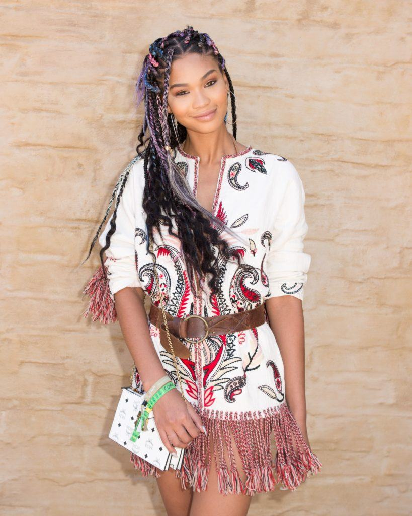 Chanel Iman with loose box braids hairstyle at coachella, wearing a boho outfit.