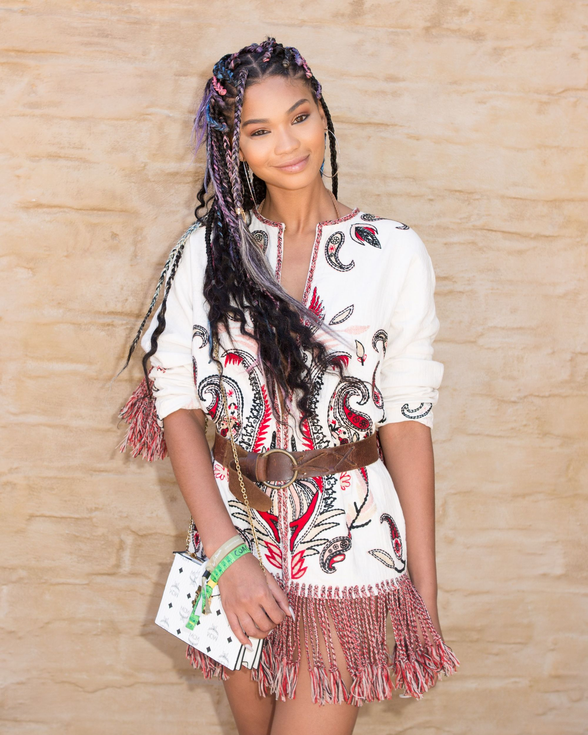Chanel Iman with loose box braids hairstyle at coachella, wearing boho outfit