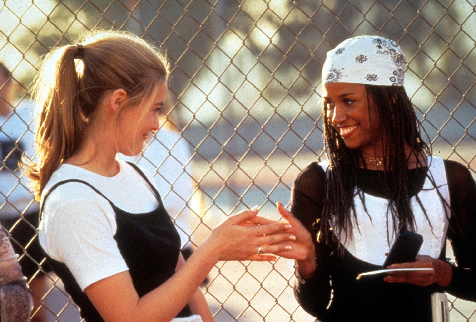 90s hairstyles: Dionne from Clueless with long box braids with white bandana in picture from Clueless