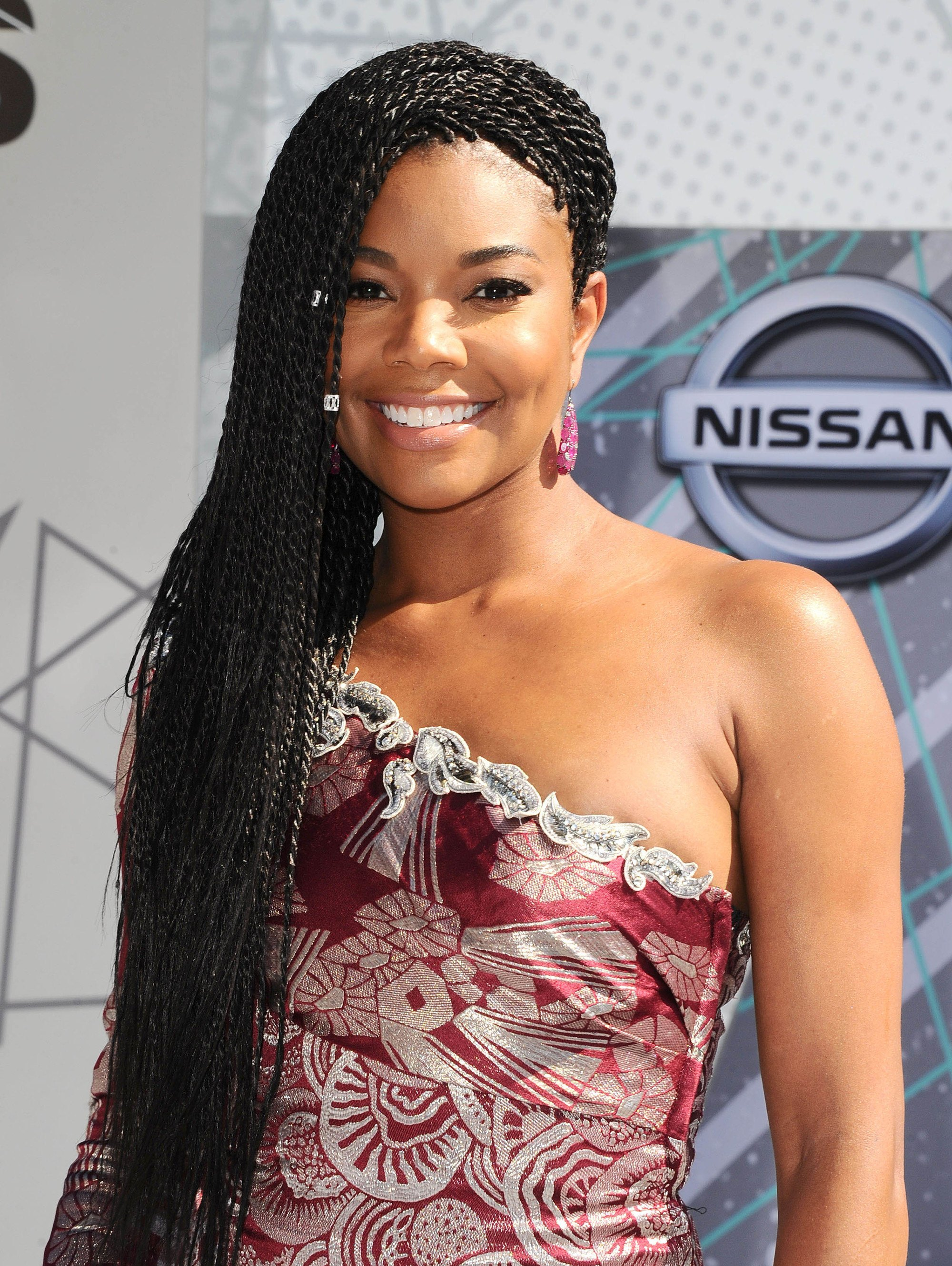 '90s hairstyles: Gabrielle Union protective braided hairstyle wearing one shoulder dress