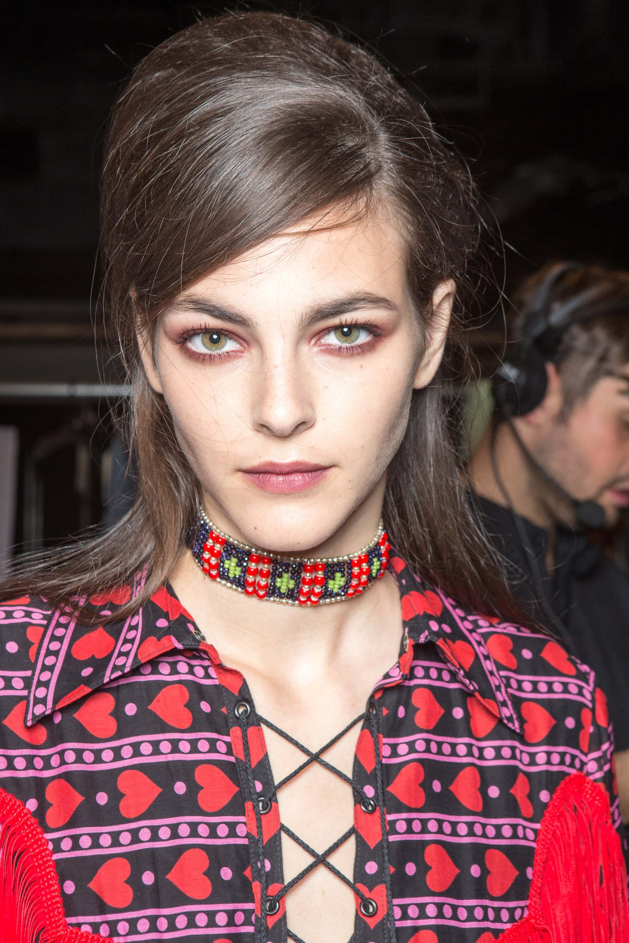 close up shot of model with half up half down vintage hairstyle backstage at anna sui