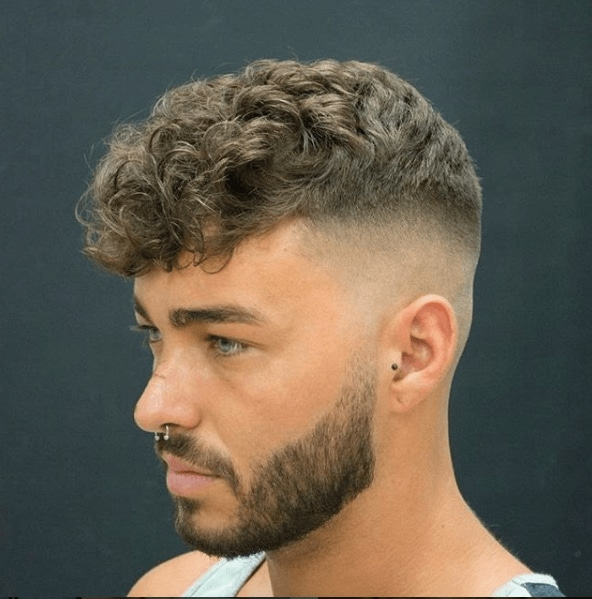 Side View Of Light Brown Bald Fade With Curly Top