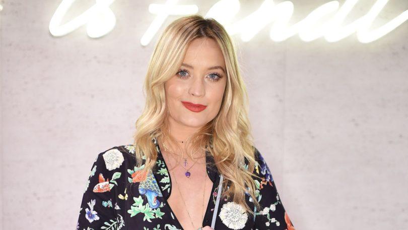 presenter laura whitmore in a floral dress with her blonde hair curly