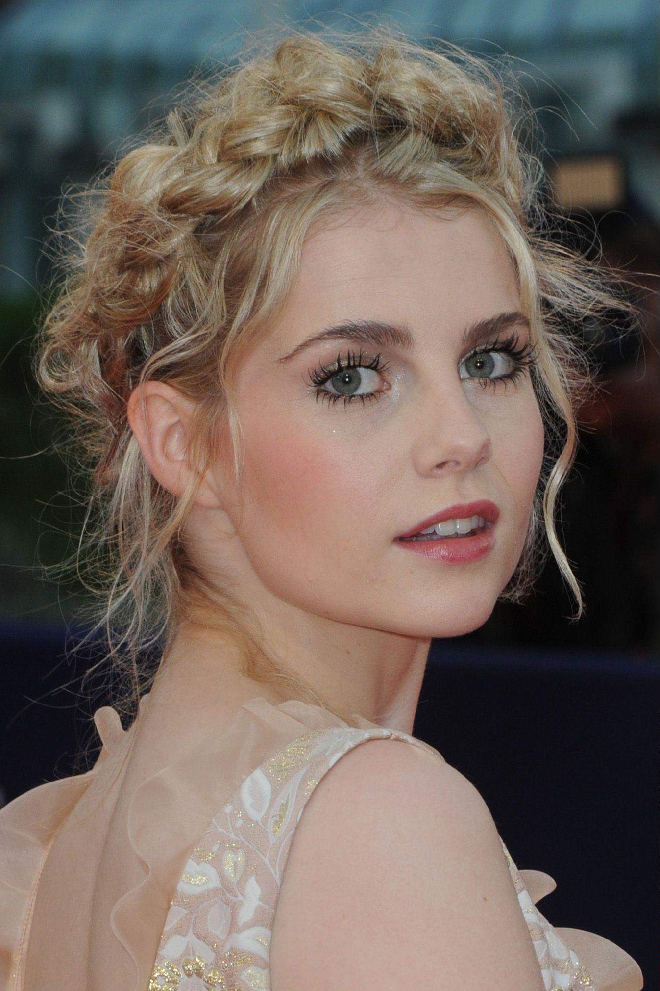 Greek hairstyles 8 looks thatll instantly make you feel like a goddess grecian hairstyles close up shot of lucy boynton with romantic milkmaid braid hairstyle solutioingenieria Gallery