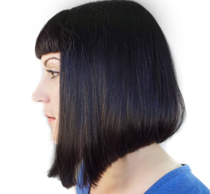 shot of woman with medium a line with bangs in a salon posing