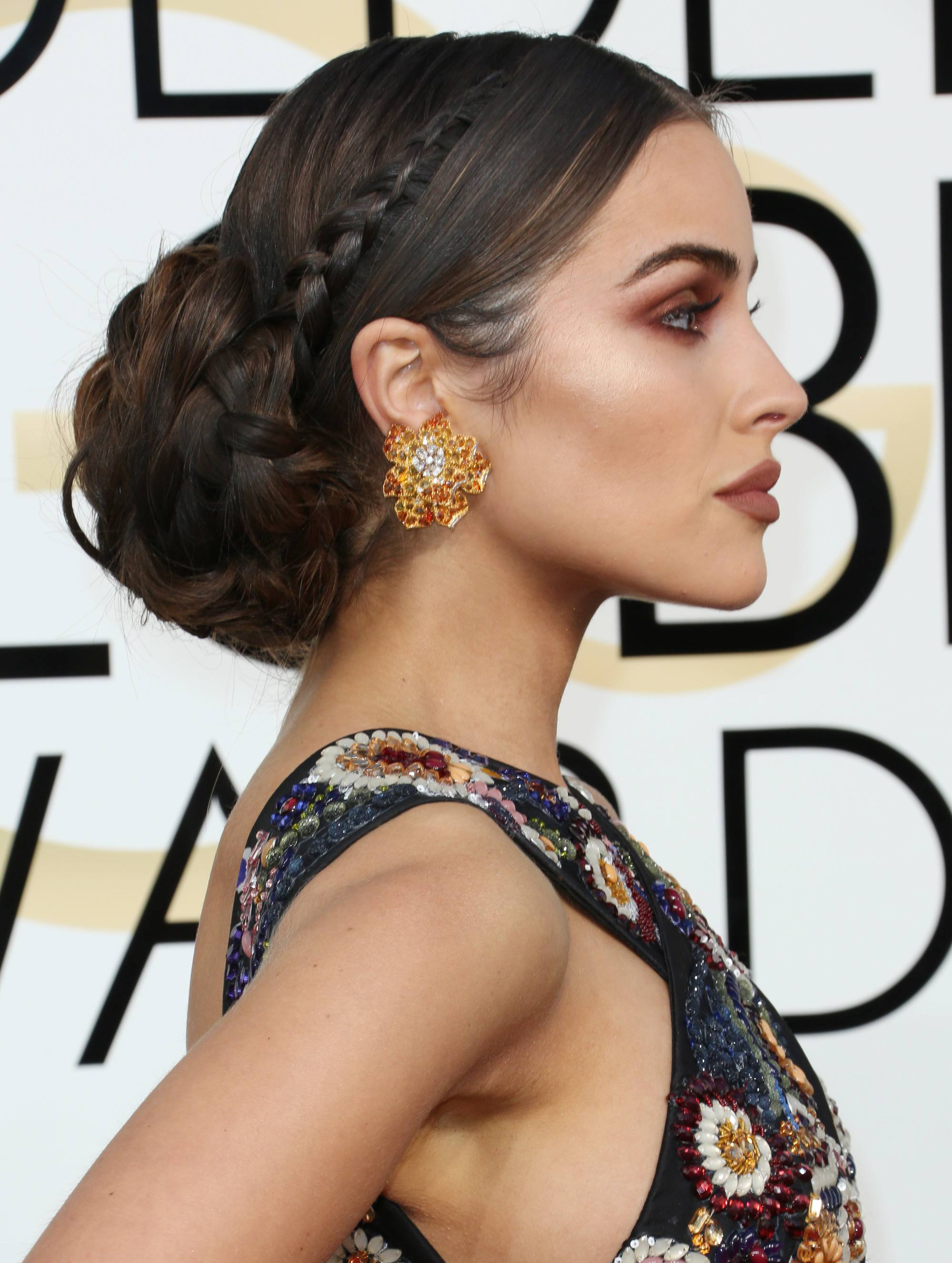 Greek hairstyles 8 looks thatll instantly make you feel like a goddess greek hairstyles side shot of oliviia culpo with braided low bun hairstyle solutioingenieria Gallery