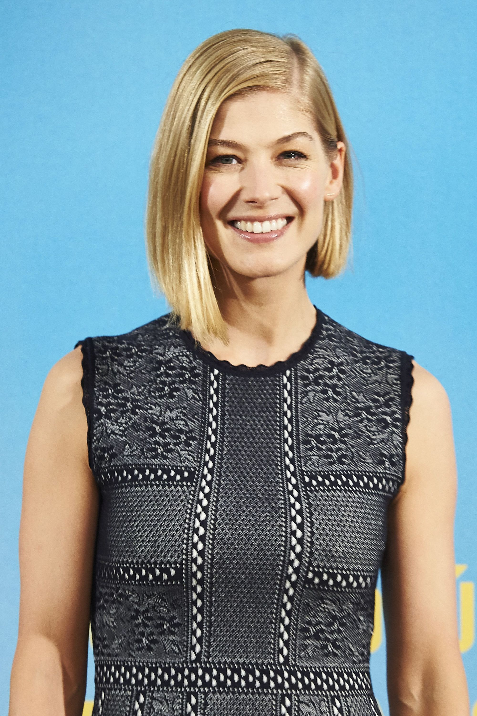 Rosamund Pike blonde hair asymmetrical bob