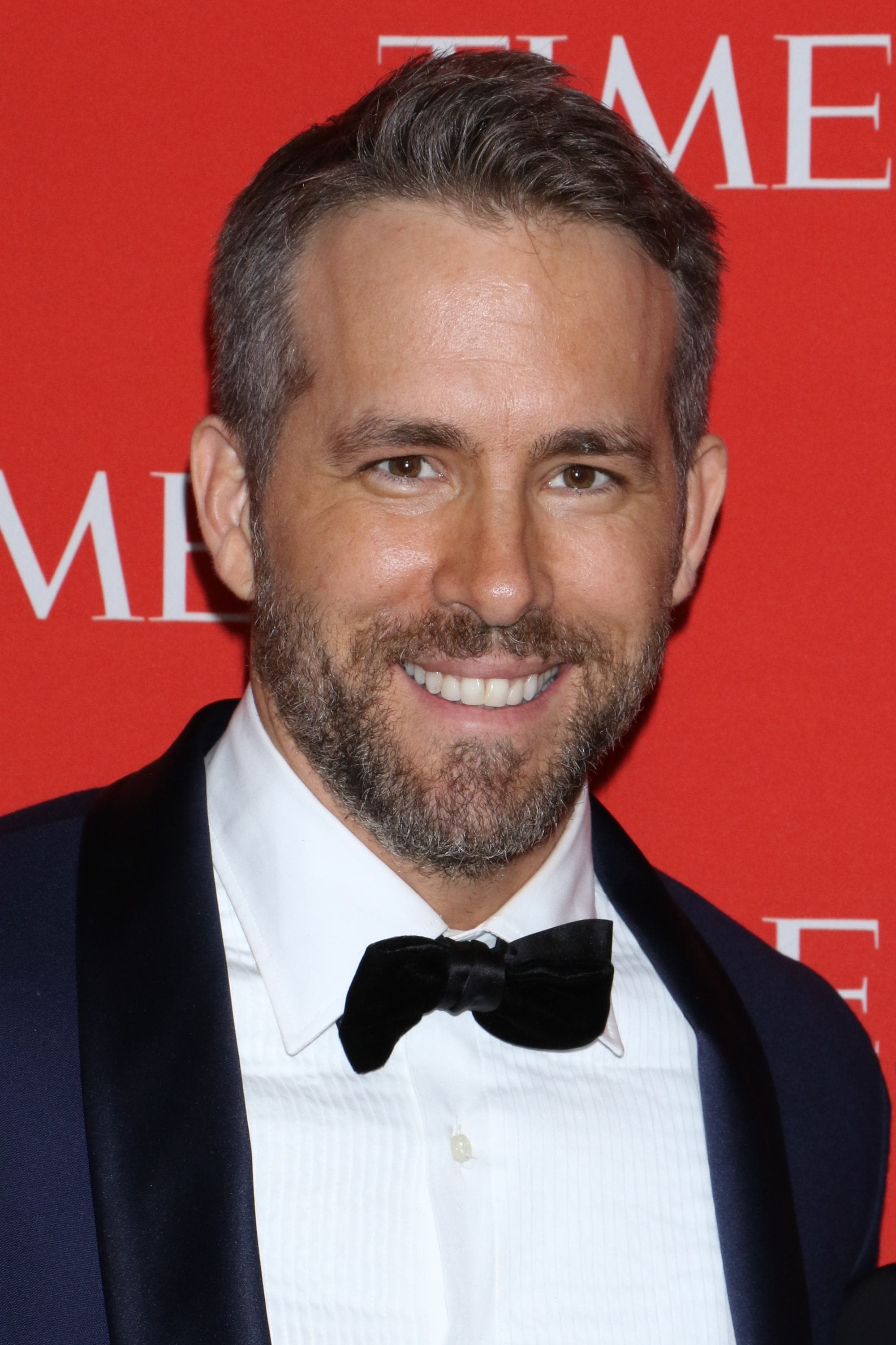 Ryan Reynolds light brown hair in taper cut on red carpet