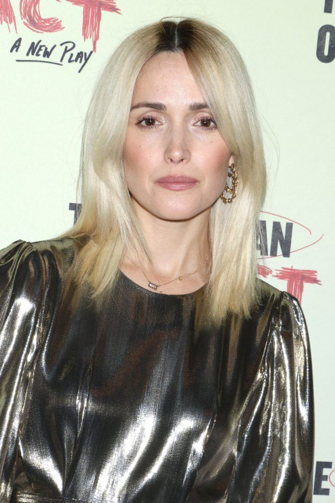 Fall hair colours: Rose Byrne shoulder length bleach blonde hair with dark roots wearing a metallic dress.