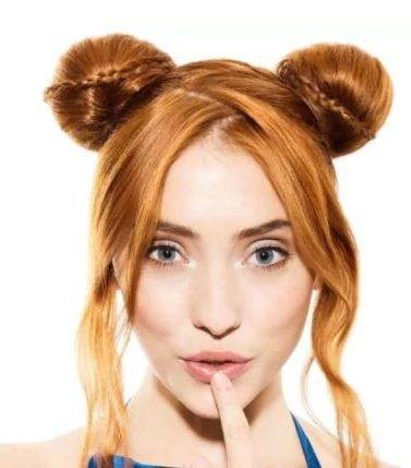 redhead model with her hair in space buns