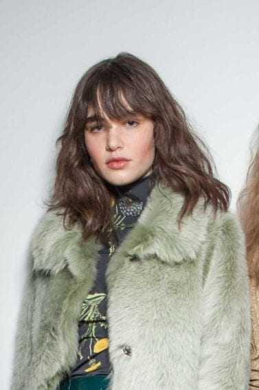 Topshop models backstage with various wavy hair