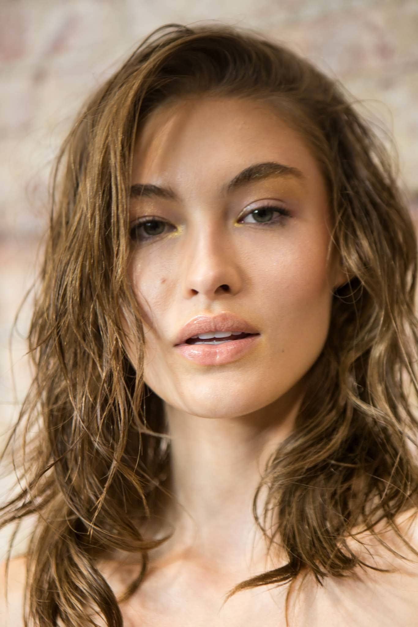 what is hair mousse: backstage shot of model with voluminous locks