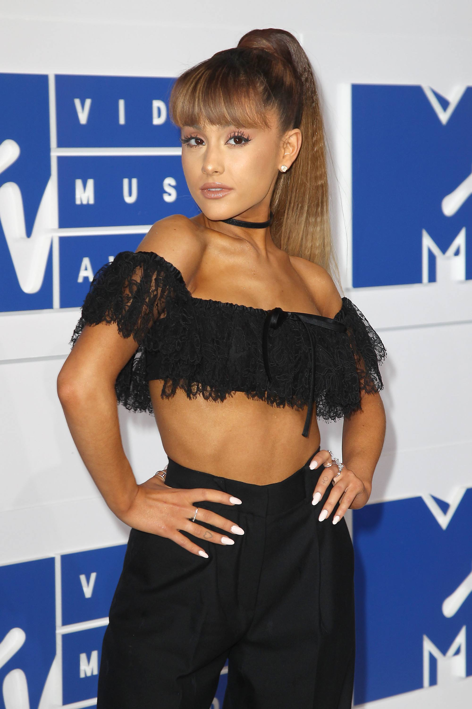 Ponytail with bangs: Ariana Grande with golden brown blunt bangs and crimped ponytail at MTV music awards.