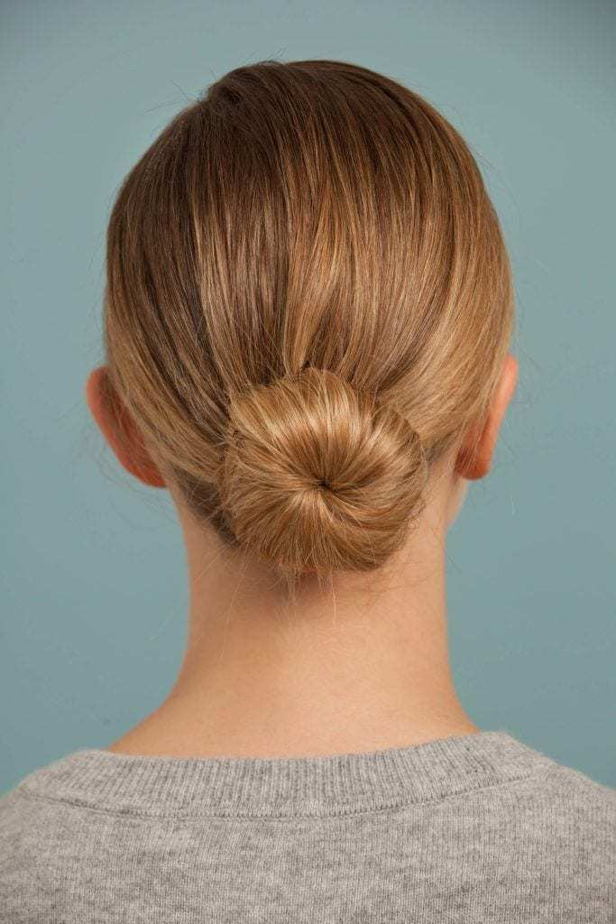 back view of blonde model with a low classic bun