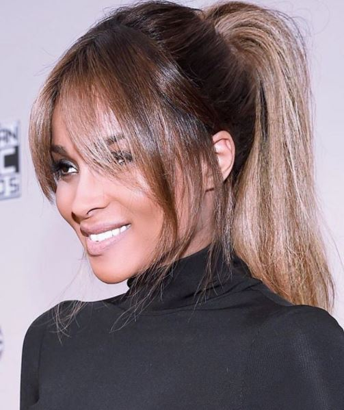 side view of ciara with light rown hair in high ponytail and bardot long bangs