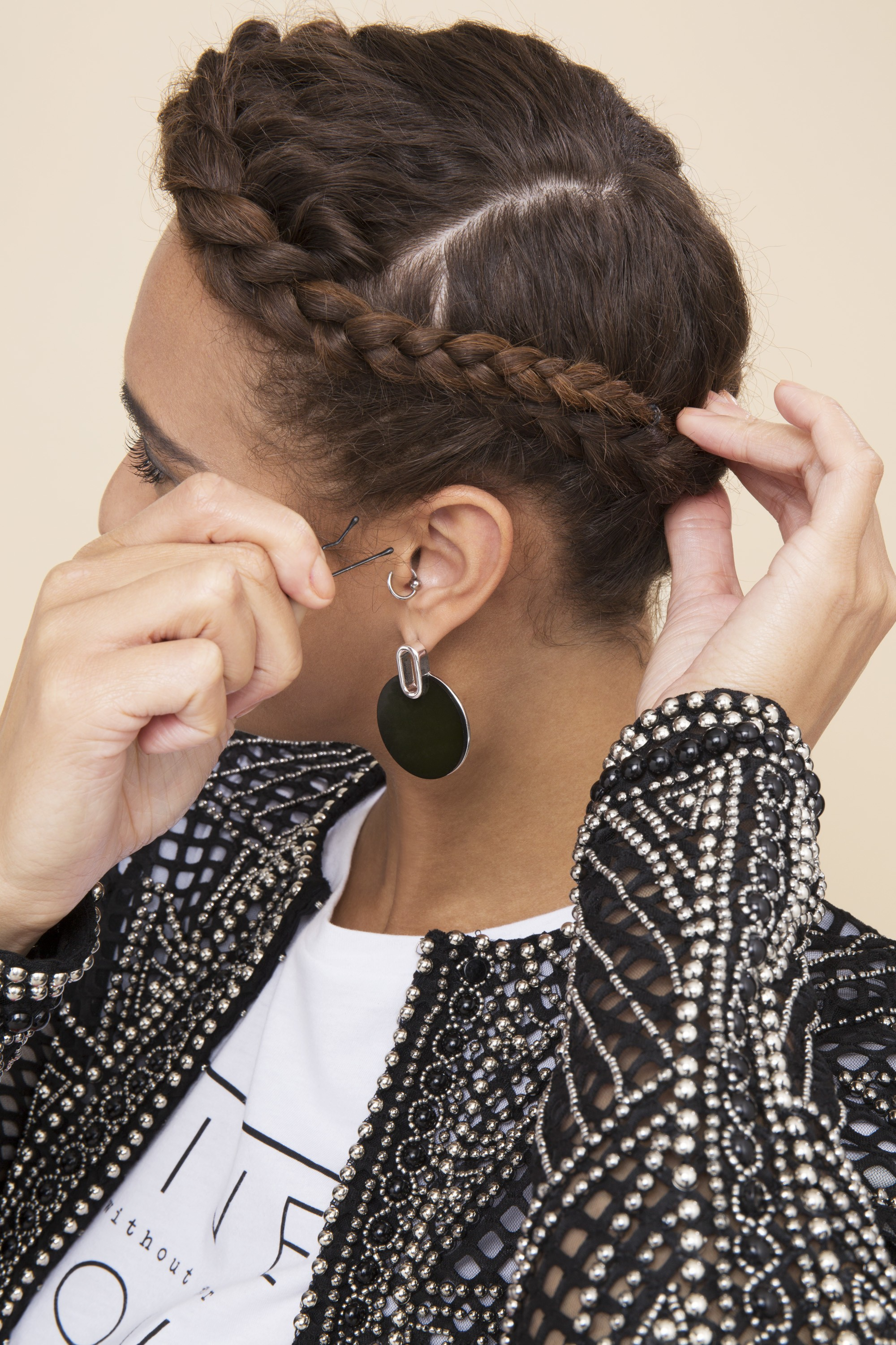 woman with afro hair in a halo braid using a kirby grip to secure the style