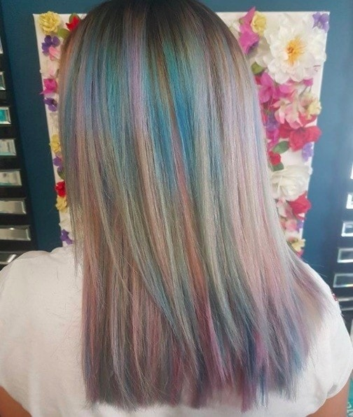 back view of a woman with blue and pink bubblegum inspired hair