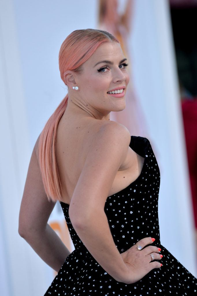 Blonde hair: Close up shot of Dawson's Creek star Busy Philipps with rose gold hair styled into a low ponytail.