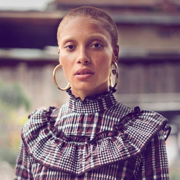 front view of model Adwoa Aboah with short buzz cut brown hair