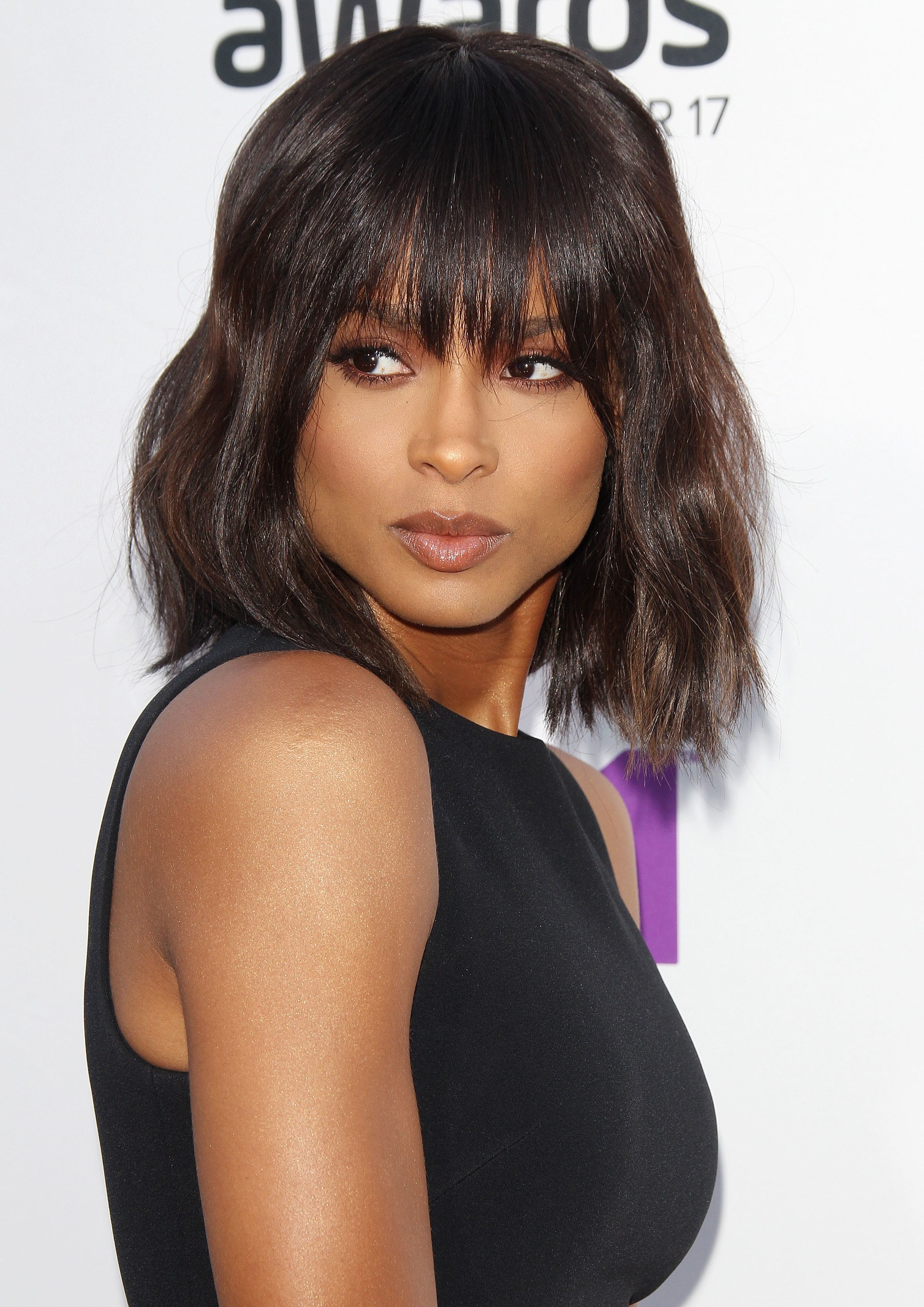 front view of ciara with dark brown hair in shag haircut with fringe