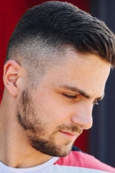 side profile shot of a man with a classic crew cut and fade detail