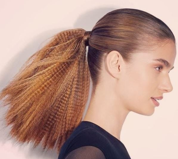 Crimped hair  Woman with dark blonde hair in ponytail with crimped ends  wearing a black 165dc5e31