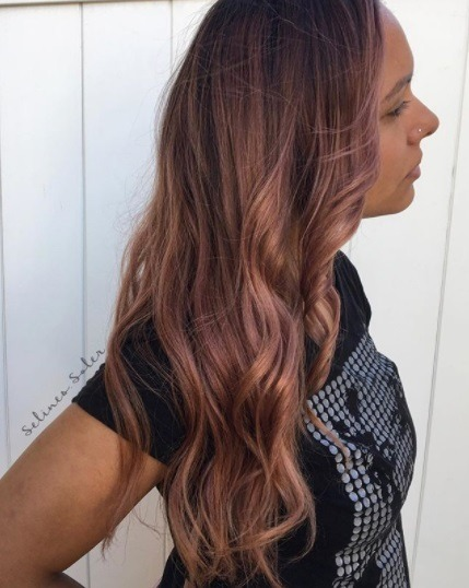 side profile of a woman with dark rose gold long hair
