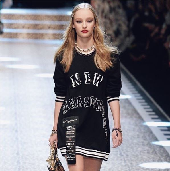 maddi waterhouse on dolce and gabbana catwalk with long blonde hair with hair slides at the front
