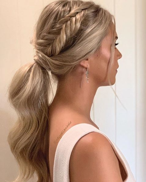 Fishtail braids: Woman with golden blonde highlighted hair in a ponytail with a fishtail braid accent.