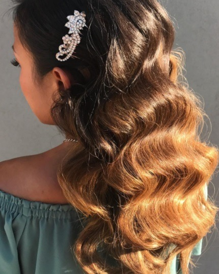 6 formal hairstyles for long hair to help you prep for party season back view of a brunette woman with long glamorous waves urmus Choice Image