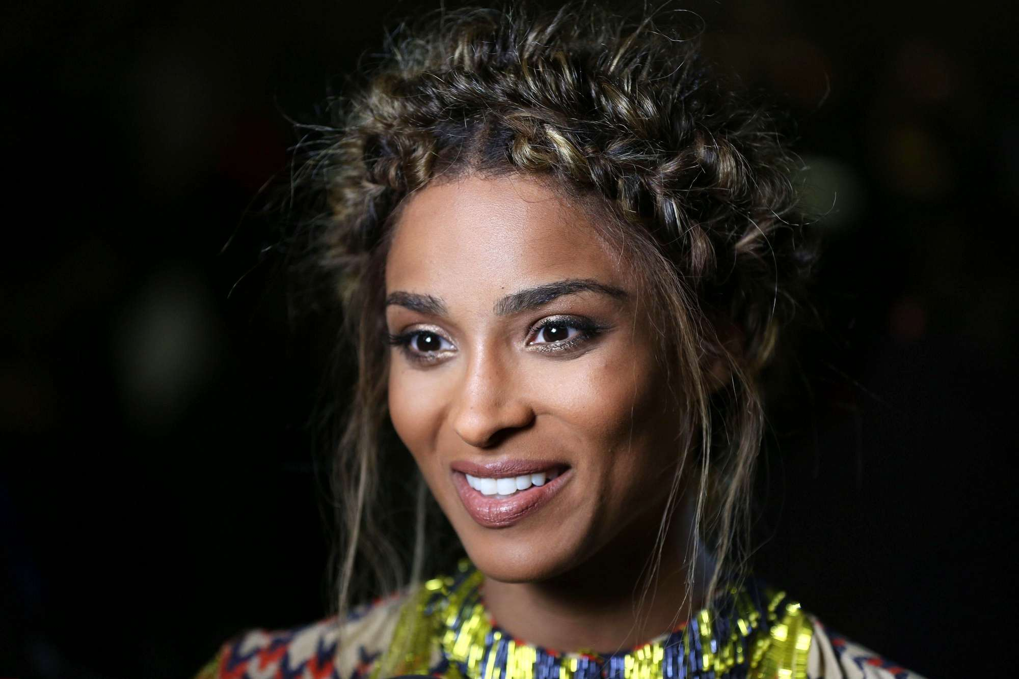 front view of ciara with medium brown hair in halo braid