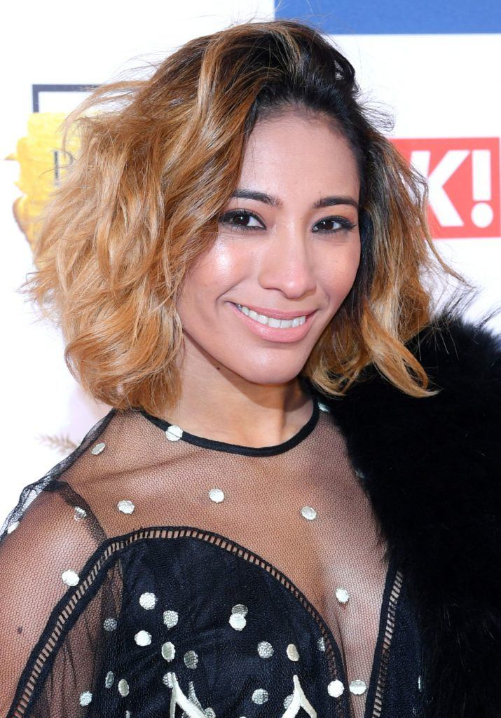 close up shot of karen clifton on the ok beauty awards red carpet, with beachy ombre hair and netted black dress and faux fur scarf