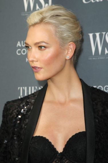 Side view of Karlie Kloss platinum blonde hair in French twist hairstyle