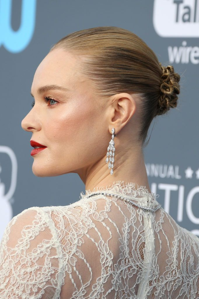 Easy hairstyles for fine hair: Kate Bosworth with straight highlighted blonde hair in sleek braided bun.
