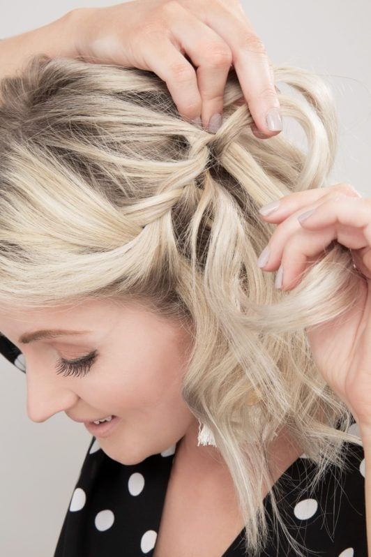 How to do a waterfall braid: Close-up of influencer Laura's Little Locket braiding her blonde wavy bob