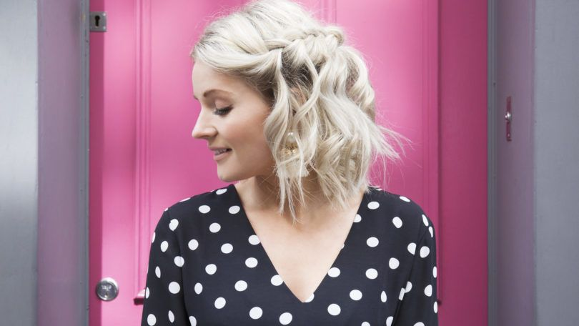 How to do a waterfall braid: Side view of influencer Laura's Little Locket with blonde short curly hair with a waterfall braid