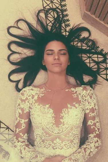 birds eye view of kendall jenner with long dark hair in love heart shapes