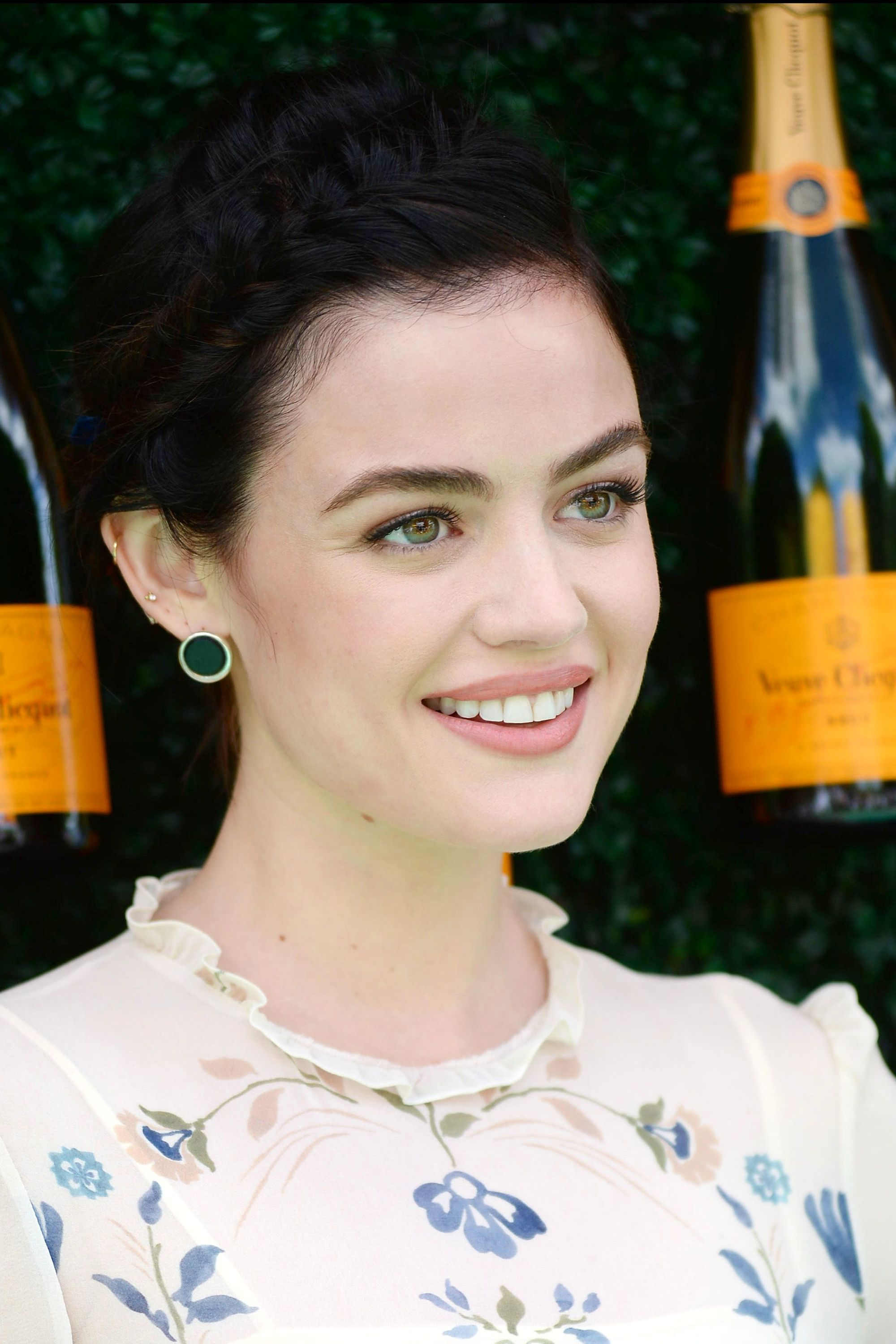 Formal hairstyles for short hair: front view of lucy hale with dark brown bob length hair with headband braid
