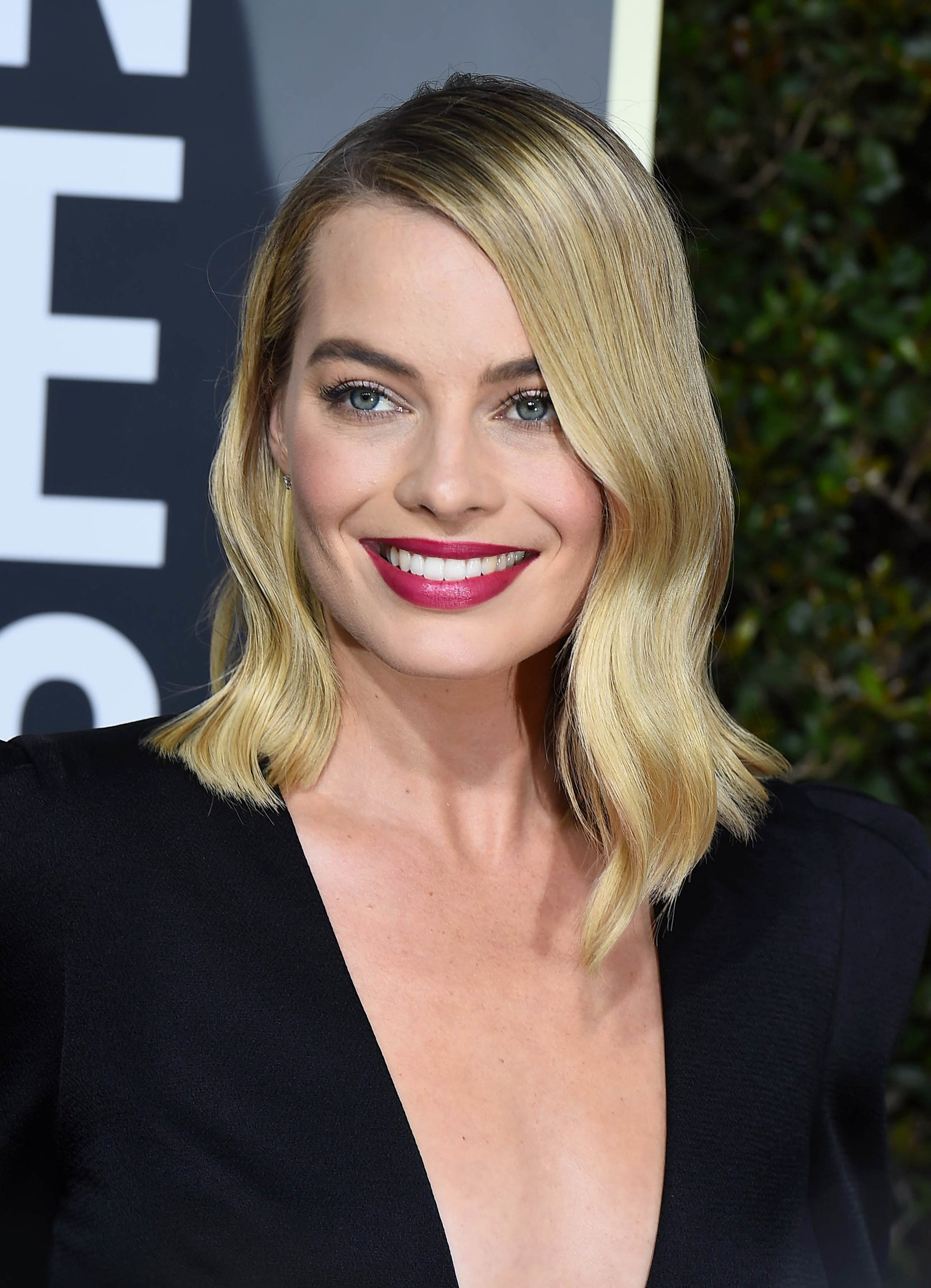 Blonde hair: Close up shot of Margot Robbie with golden blonde hair mid-length wavy hair.