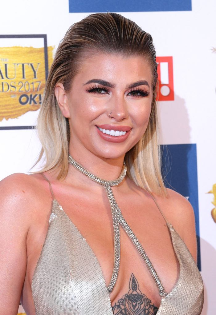 close up shot of Olivia buckland with slicked back hair, wearing gold dress on the ok beauty awards red carpet