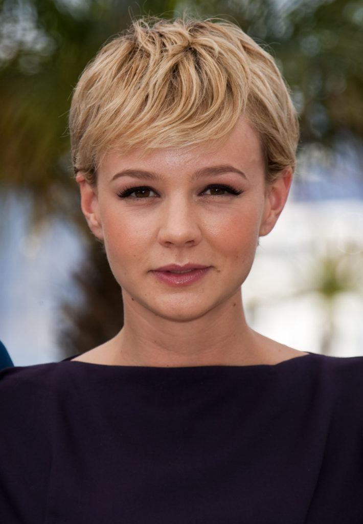 front view of carey mulligan with blonde pixie and side sweeping bangs