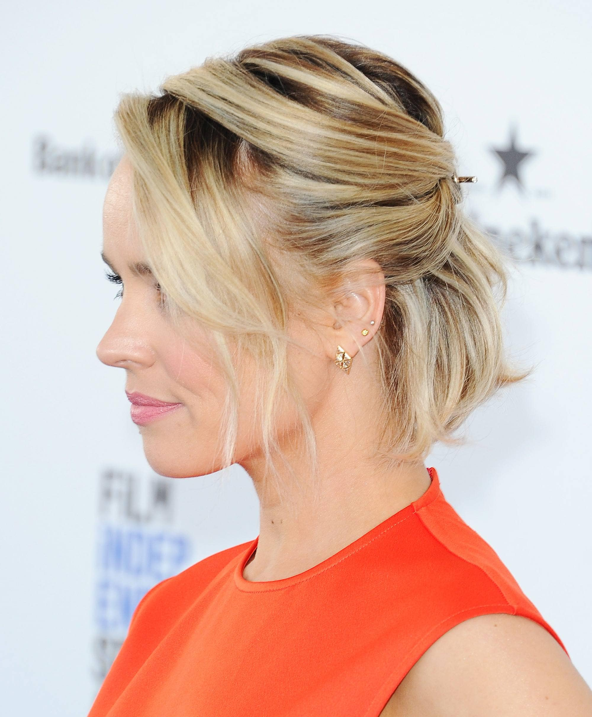 Formal hairstyles for short hair: side view of rachel mcadams blonde bob length hair in half-up, half-down style
