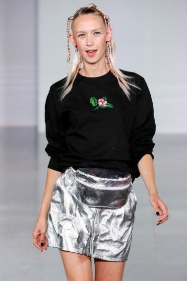 Ideas for crazy hair day: Blonde runway model with her hair in tiny random braids, wearing a black sweatshirt and silver skirt