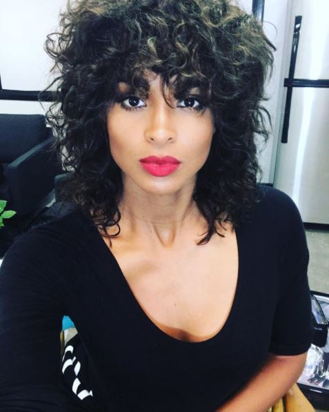 Front Vie Of Ciara With Dark Brown Shoulder Length Curly Perm Fringe