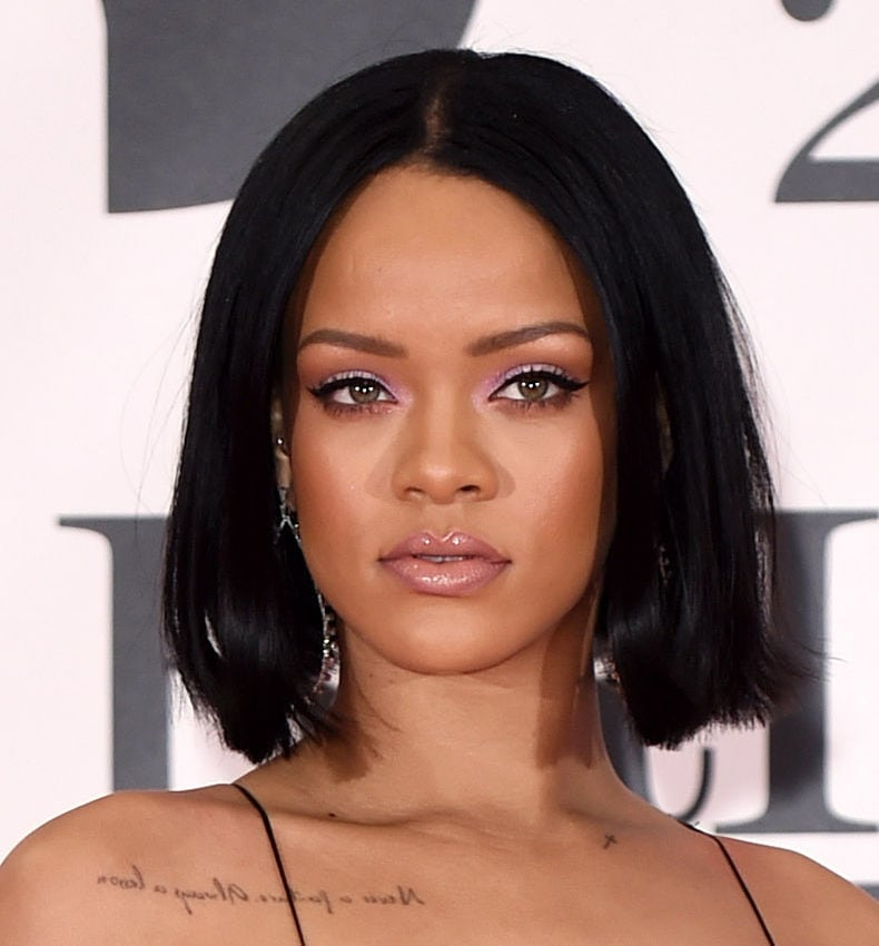 close up shot of rihanna on the brit awards red carpet, with blunt bob with flicked out ends hairstyle