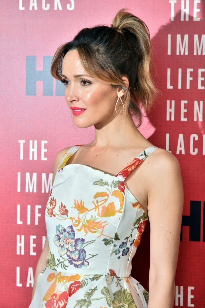 Ponytail with bangs: Rose Byrne with bardot bangs and high ponytail on brown medium length balayage hair.