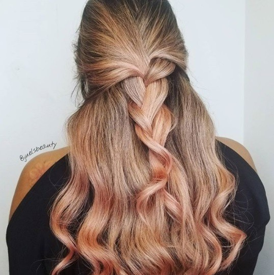 photo of a woman with rose gold pink hair with a half up braid