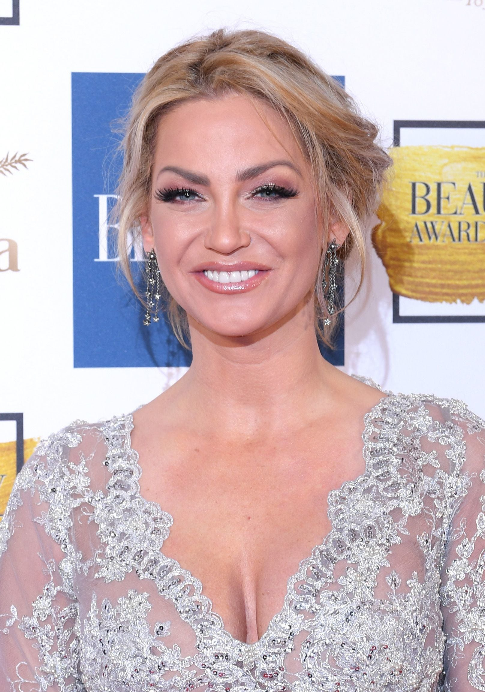 close up shot of sarah harding with romantic updo hairstyke, wearing silver dress at the ok magazine beauty awards