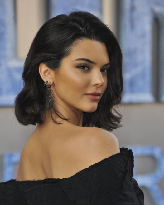 side view of kendall jenner with long bob dark hair with slight curl